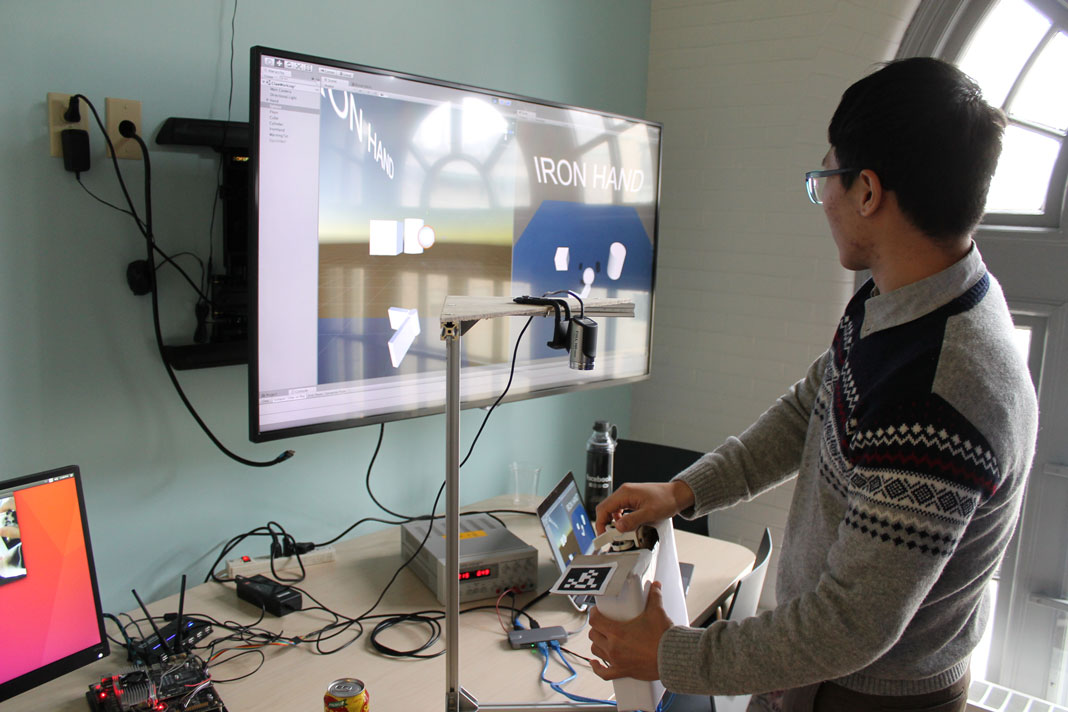 Photo of our force feedback controller being demoed